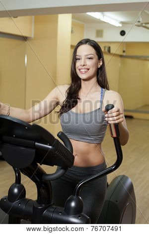 Working Out On Elliptical Trainer
