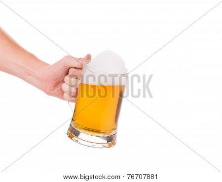 Mug of beer in hand.