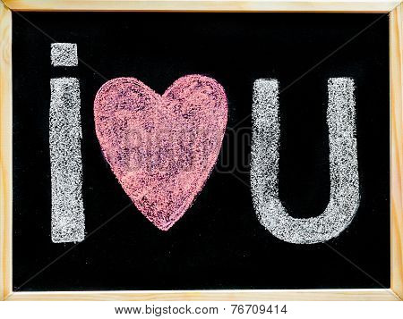 I Love You Message Hand Written With Chalk On Blackboard, Word Love Replaced By Heart Shape