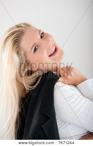 young attractive business woman in black suit