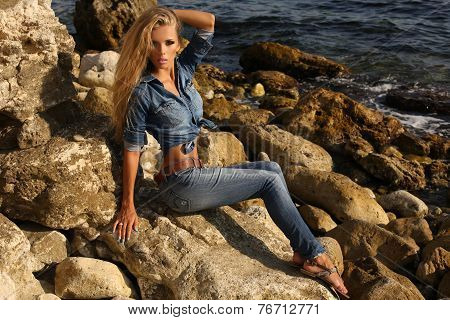 Pretty Girl With Long Blond Hair In Jeans Clothes Posing On Summer Beach