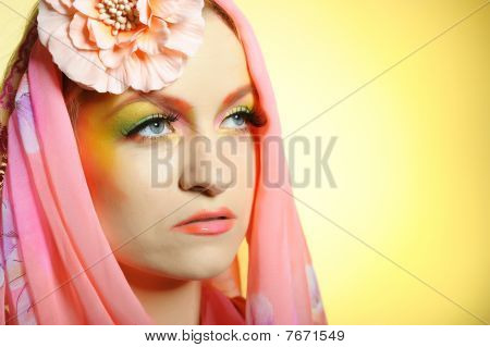 Close-up Portrait Of Summer Beautiful Woman With Fashion Creative Eye Make-up In Yellow And Green To