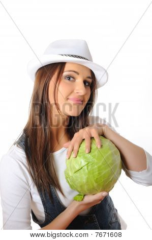 Young Pretty Woman With Green Beautiful Cabbage . Isolated On White Background