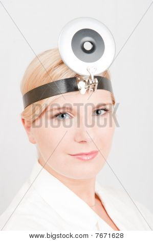 Beautiful female doctor with medical tool. gray background