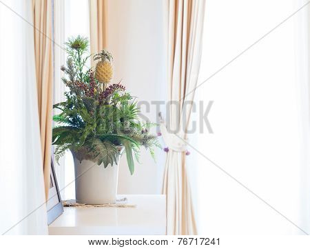 Artificial Flowers Bouquet On Window Sill Frame With Curtains