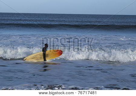 Surfer planning next ride