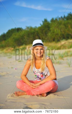 beautiful summer woman relaxing on the beach