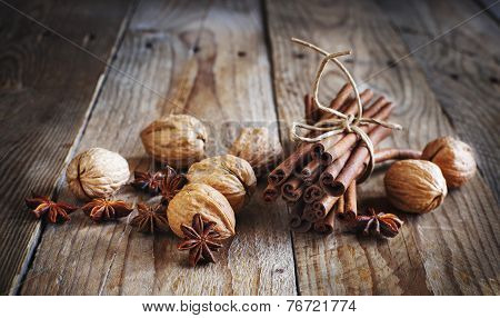Christmas Spices (cinnamon Sticks, Star Anise, And Walnuts)