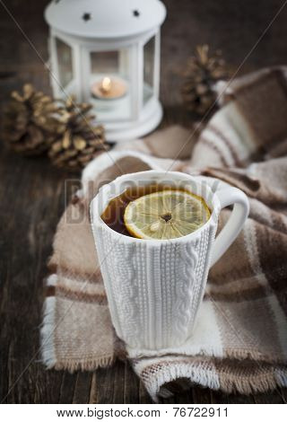 Cup Of Hot Tea With Lemon And Scarf On Wooden Table