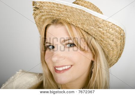 young beautiful summer farm woman in large hat