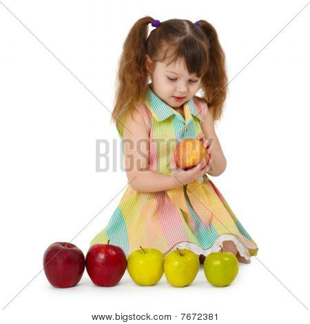 Little Girl On White Background With Apples