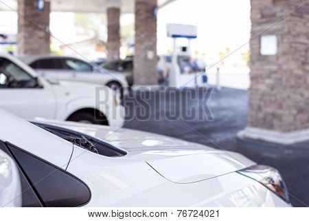 Line Of Cars Refilling At Gasoline Station In The Afternoon