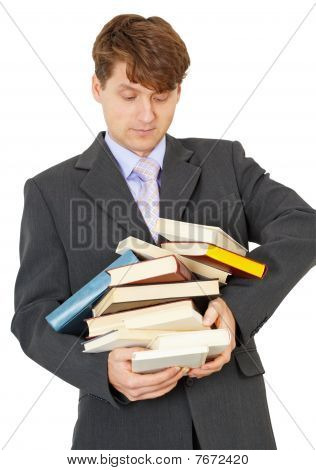 Student Bears Big Pile Of Textbooks In Hands
