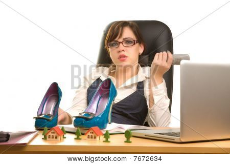 Businesswoman With Telephone In Her Hands