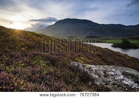 Stunning Summer Dawn Over Mountain Range With Lake And Beautiful Sky