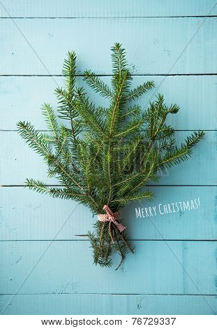 Christmas Bouquet Of Firtree Branch On Blue Painted Wooden Background.