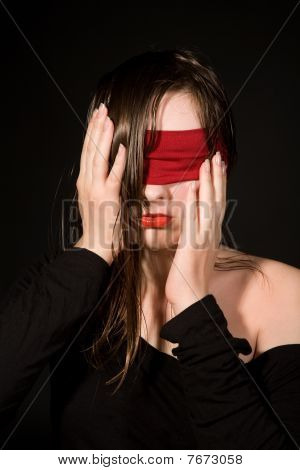 Young Woman With  Bandage On Her Eyes