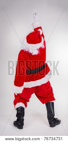 Studio photo of Santa Claus showing rude gesture of middle finger