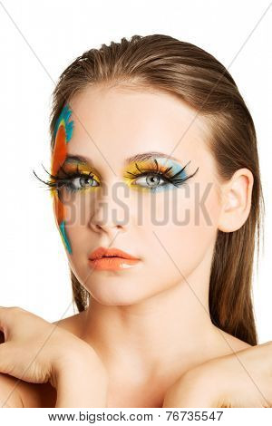 Portrait of nude woman with an artistic make up.