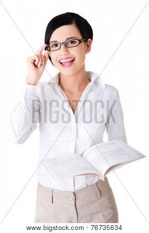 Portrait of woman in eyewear holding a book.