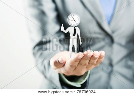 Figure of punctual businessman on palm