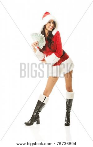 Full length santa woman holding a clip of polish money, standing astride.