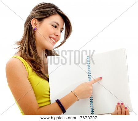 Woman Pointing In A Notebook