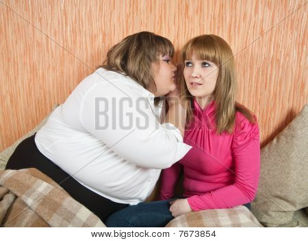 Two Girls Sharing A Secret