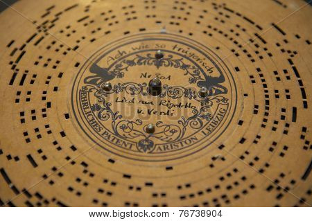 Vintage paper mechanical music disk with Rigoletto by Verdi recorded.