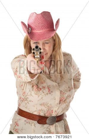 Woman With Pink Cowboy Hat Pointing A Loaded Pistol