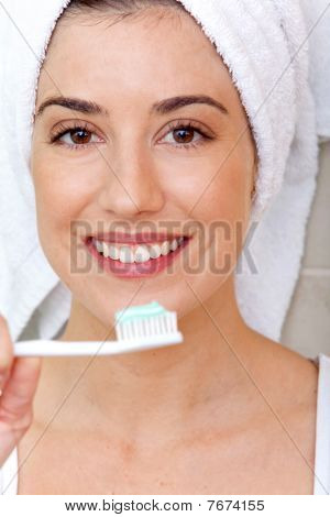 Woman Holdin A Toothbrush