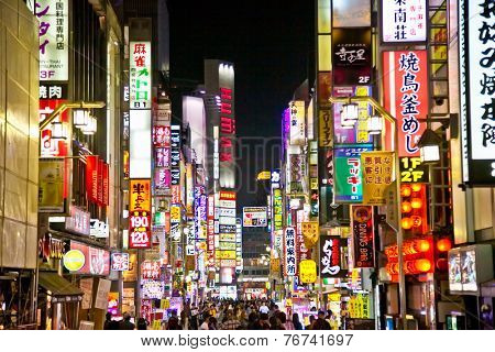 TOKYO, JAPAN -OCT 26, 2014: Billboards in Shinjuku's Kabuki-cho district Oct 26, 2014 , Tokyo, Japan. The area is a nightlife district known as Sleepless Town.