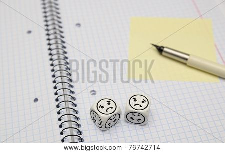 Open Exercise Book With Mood Dice (sad) And Yellow Sticky Card