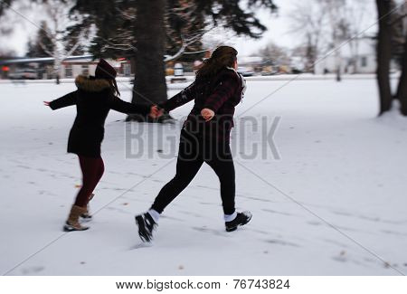 Girls Running in the Snow
