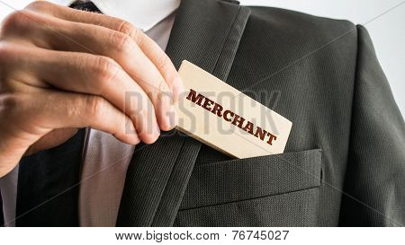 Man Removing A Wooden Sign Saying Merchant