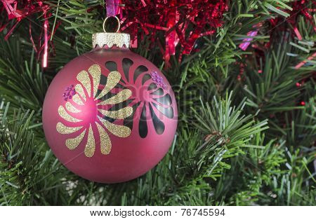 Red Christmas Bauble Hanging On A Tree