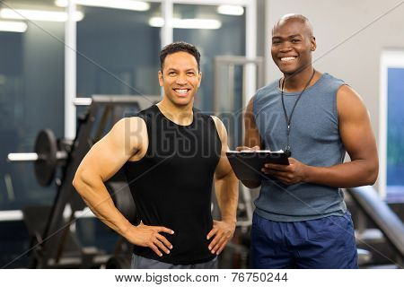 portrait of african american fitness instructor with client