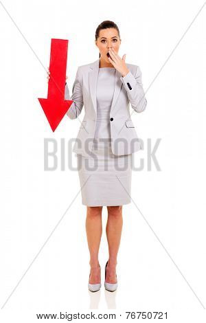 surprised business woman with arrow pointing down isolated on white