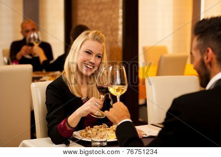 Young Couple Eat Sea Food Dinner At Restaurant And Drink Wine