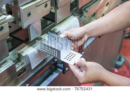 Worker At Manufacture Workshop Operating Cidan Folding Machine