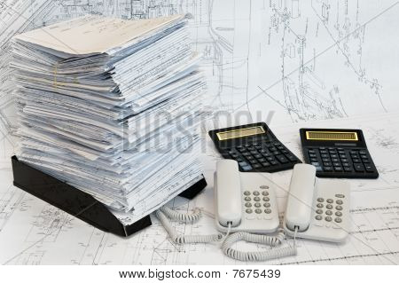 Big Heap Of Design And Project Drawings, Two Calculators And Two Telephoes