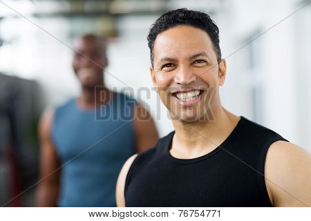 handsome mid age male gym trainer closeup portrait
