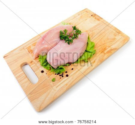 raw uncooked chicken on cutting board