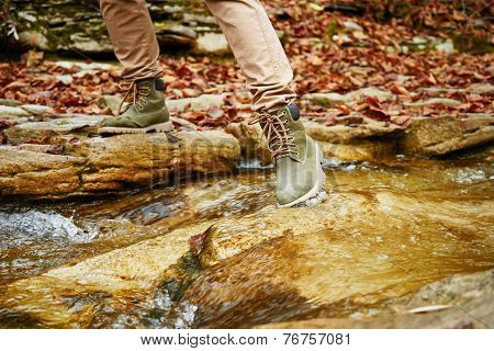 Hiker Woman Crossing A Stream, View Of Legs