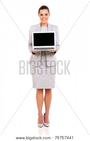 full length portrait of businesswoman presenting laptop