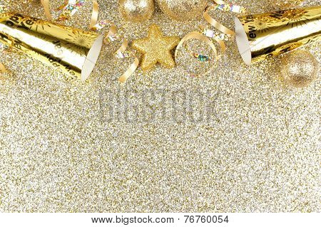 New Years Eve border on shiny gold background
