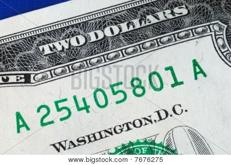 Close up view of the serial number of a dollar bill