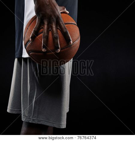 African Basketball Player Holding Ball