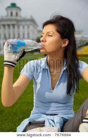 Drinking Mineral Water In The Park
