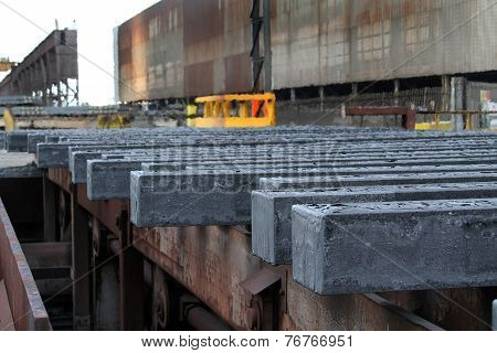 Hot steel bars on cooling bank.